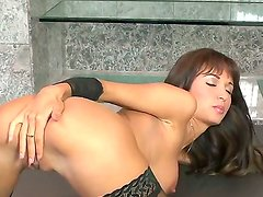 Euro glamour girl in black stockings and high heeled shoes is talking so dirty and