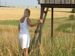 Horn-mad blondie finds a hut in the filed and provides a dude with a handjob