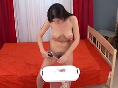 Pretty slim brunette gets ready for sex and shaves her wet hairy pussy