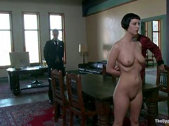 Chained brunette girl walks naked around the room
