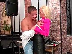 Flirty chick in pink satin blouse sucks his dick