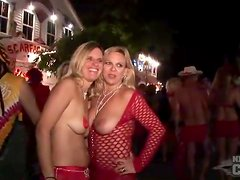 Scantily clad costume girls at street party