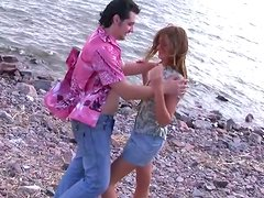 Charming girl gives hot blowjob on the rocky beach