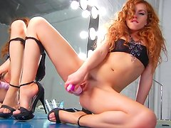 Curly-haired redhead pornstar plays with dildo