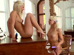 Mouth-watering blonde lesbians pound each other's pussies with dildos