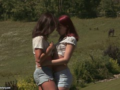 Two slim girls lick each others hot pussies outdoors