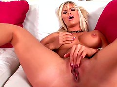 Sensual blonde is poking her accurate shaved pussy