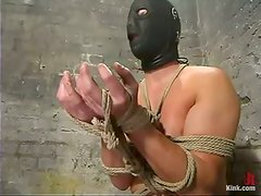 Masked Guy Cums to a Fleshlight after Getting Strapon Fucked in BDSM