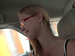 Kinky slim amateur blondie in glasses shows her ass in the car on cam
