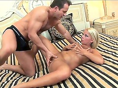 Chick with big boobs and big ass Lucy Love is relaxing with two dudes. Dudes are