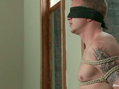 Evan Mercy gets tied up, punched and tormented in BDSM scene