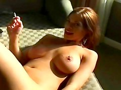 Busty slut smokes with her pussy