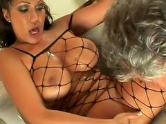 Babe in fishnet is sitting on the face