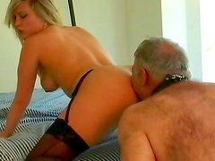 Blonde uses strapon in femdom