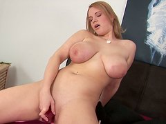 Busty blonde cutie in bed in solo seduction show with a dildo