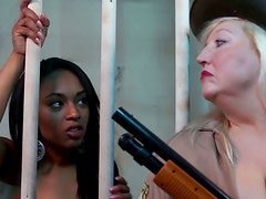 Appetizing prisoner Bella Moretti eats the pussy of Porshe Carrera in the cell
