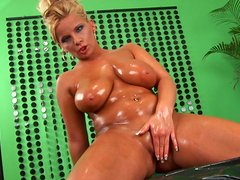 Chunky and milfie blondie Lucie plays with her huge juggs