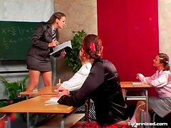 Bossy teacher and satin clad schoolgirl in class