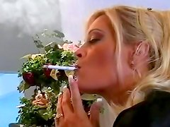 Busty milf poses and smokes