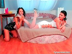 French maid sucks the toes of her mistress
