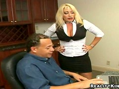 Busty blonde Jenna leans against a kitchen counter to get her vag fucked