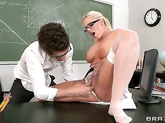 Britney Amber with giant breasts getting down and