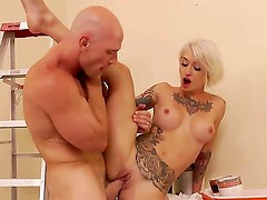 Baldheaded hugecocked stud Johnny Sins is relaxing with flexible tattooed wife Kleio Valentien. The