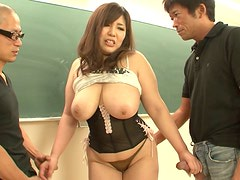 Ample Japanese hot pants get her oversized tits oral stroked in MMF sex clip