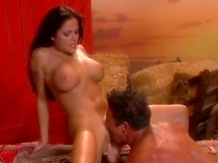 Bootylicious and busty brunette whore fucking in the barn