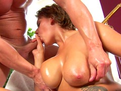 Tattooed oiled busty gal Zora turns erotic massage into a solid blowjob