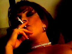Smoking brunette loves to play dirty