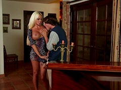 Big tittied blonde bombshell gives an unbelievable blowjob