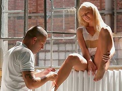 Divine blond babe gets her pedicured feet sucked hard by aroused wanker