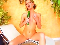 Slutty blonde fuck her herself with cucumber