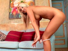 Well figured blond sweety is fondling her wet pussy