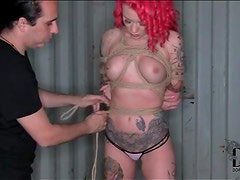 Tattooed pornstar Becky Holt tied up