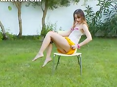 Ivana coed getting wet on the grass