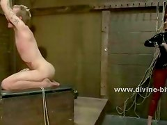 Bitch dressed in latex makes a man lick her asshole and perfect toes while he is suspended