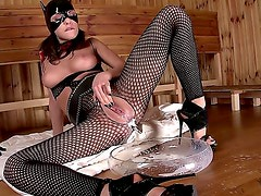 Good looking masked brunette Henessy with full juicy lips and long legs in fishnet full body