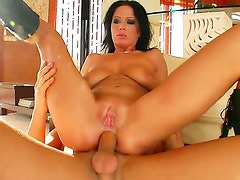 Back haired tanned Andrea with big juicy knockers and heavy make up gets her shaved minge