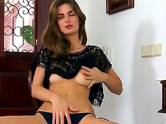 Pretty slender brunette babe Charlotta with small boobies and tight sweet ass in black lace