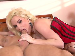 Skillful blonde bombshell Diamond Foxxx with huge fake tits and round bouncing ass in corset