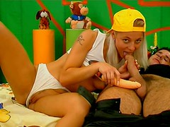 Sporty blond haired teen in cap enjoys sucking a stiff dick for tasty sperm