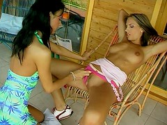Busty lesbian girls fucking each other's pussies with dildos