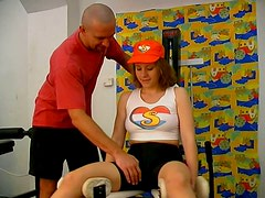 Sporty redhead chick is seduces by brutal trainer