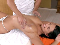 Big breasted brunette bombshell gets her pussy eaten by her masseur