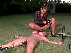 Bitch bound in the grass abused by her mistress
