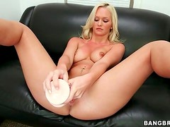 Gorgeous blonde Emily Austin strips and toys