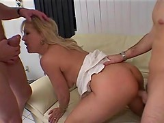 Two guys take turns with horny mature blonde