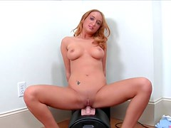 Slender redhead Leslie is solo playing with her toys